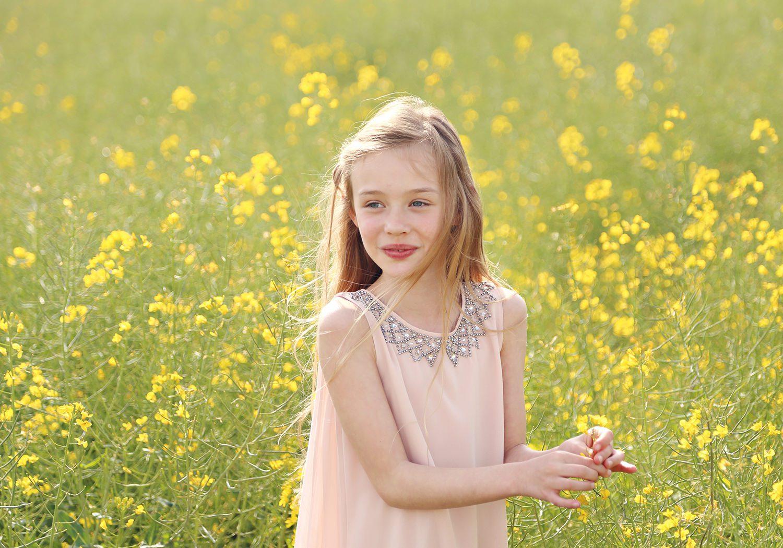 girl in rapeseed meadow