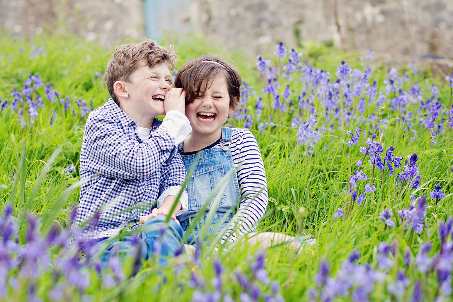 kids laughing in bluebells