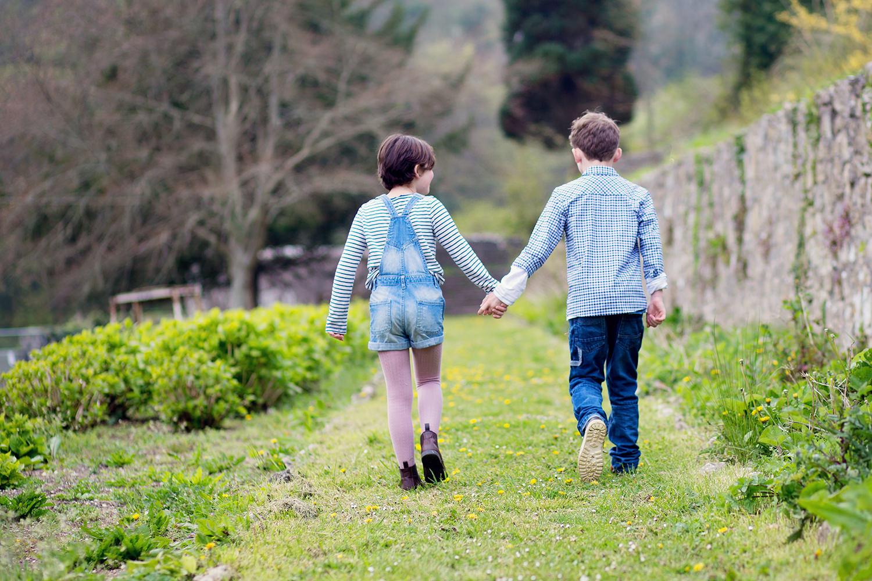 kids walking hand in hand