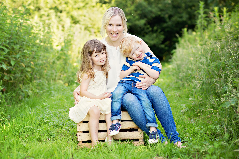 Mum and kids hugging photo shoot