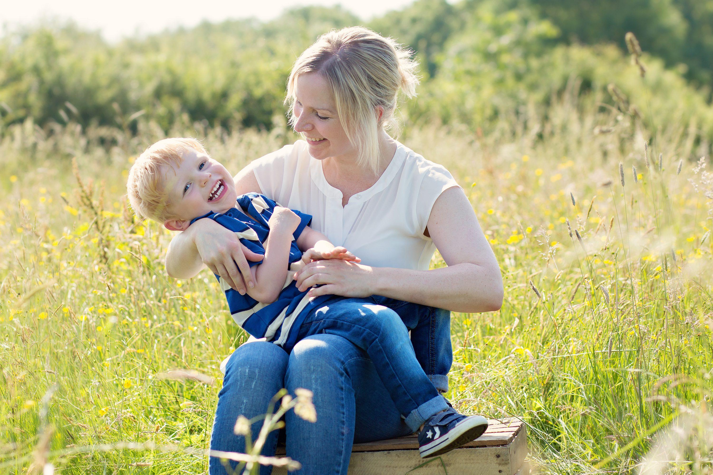Mum and son in meadow Llysworney