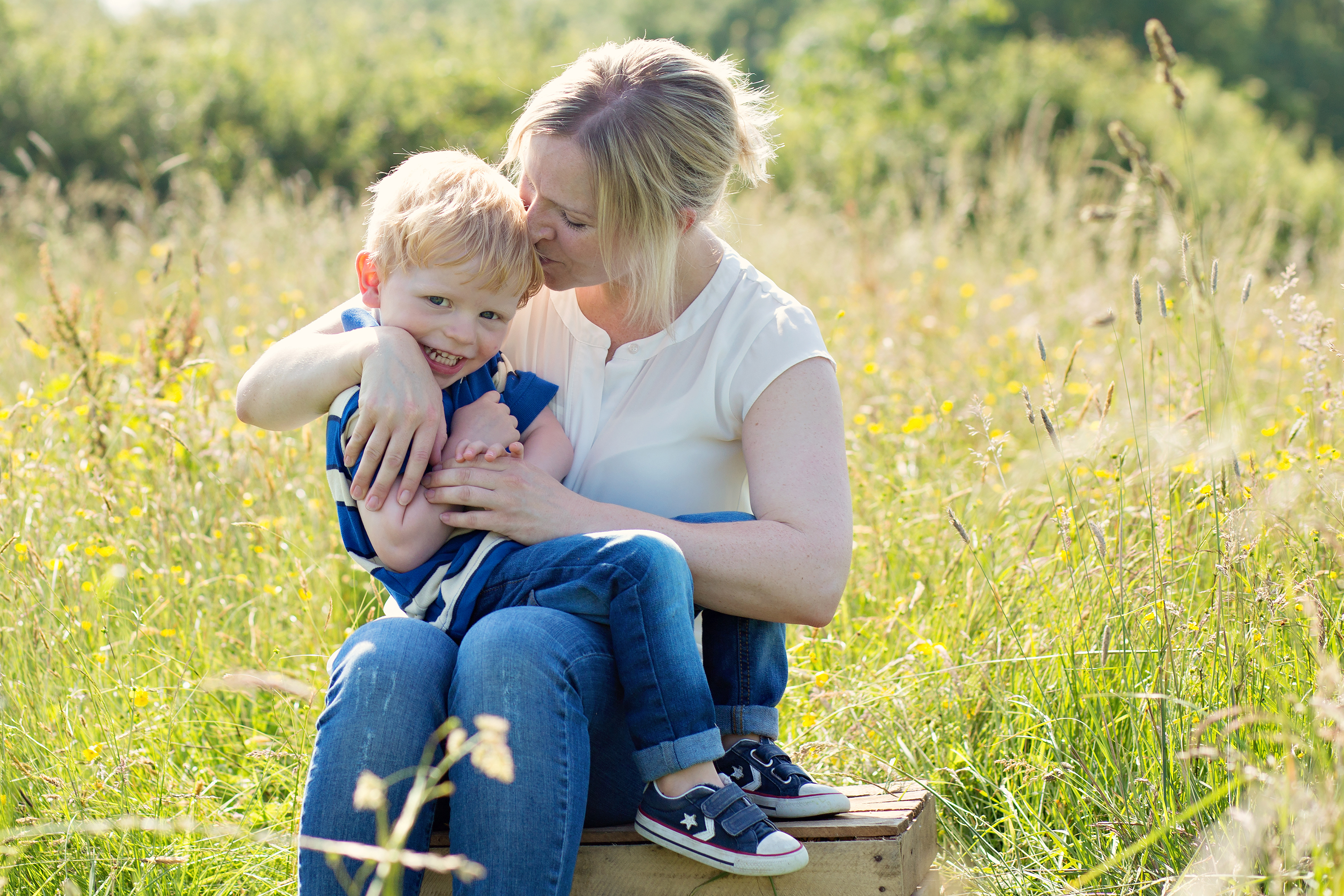 Mum and son in meadow