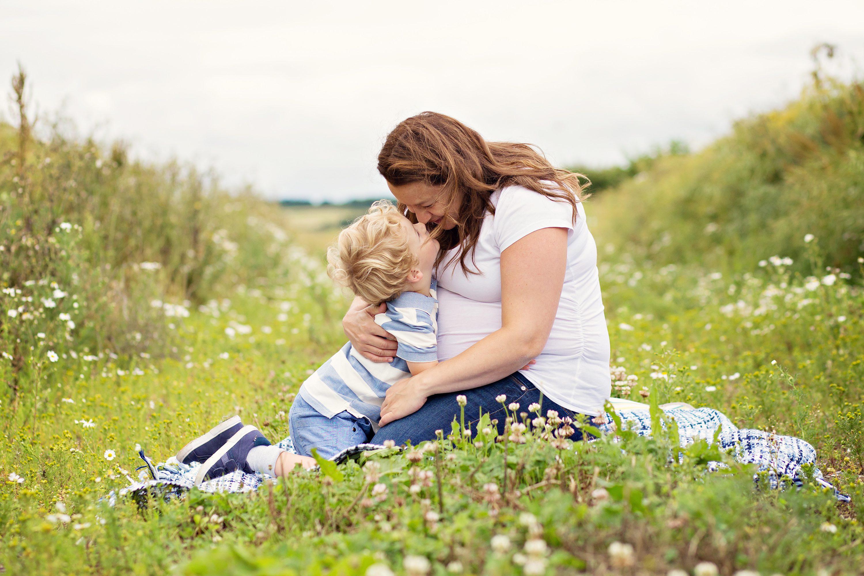 Mum snuggling son in Llandow