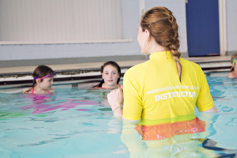 mermaid swimming instructor