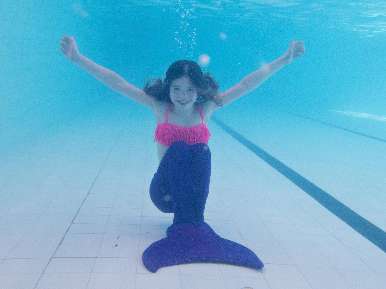 girl underwater in mermaid tail