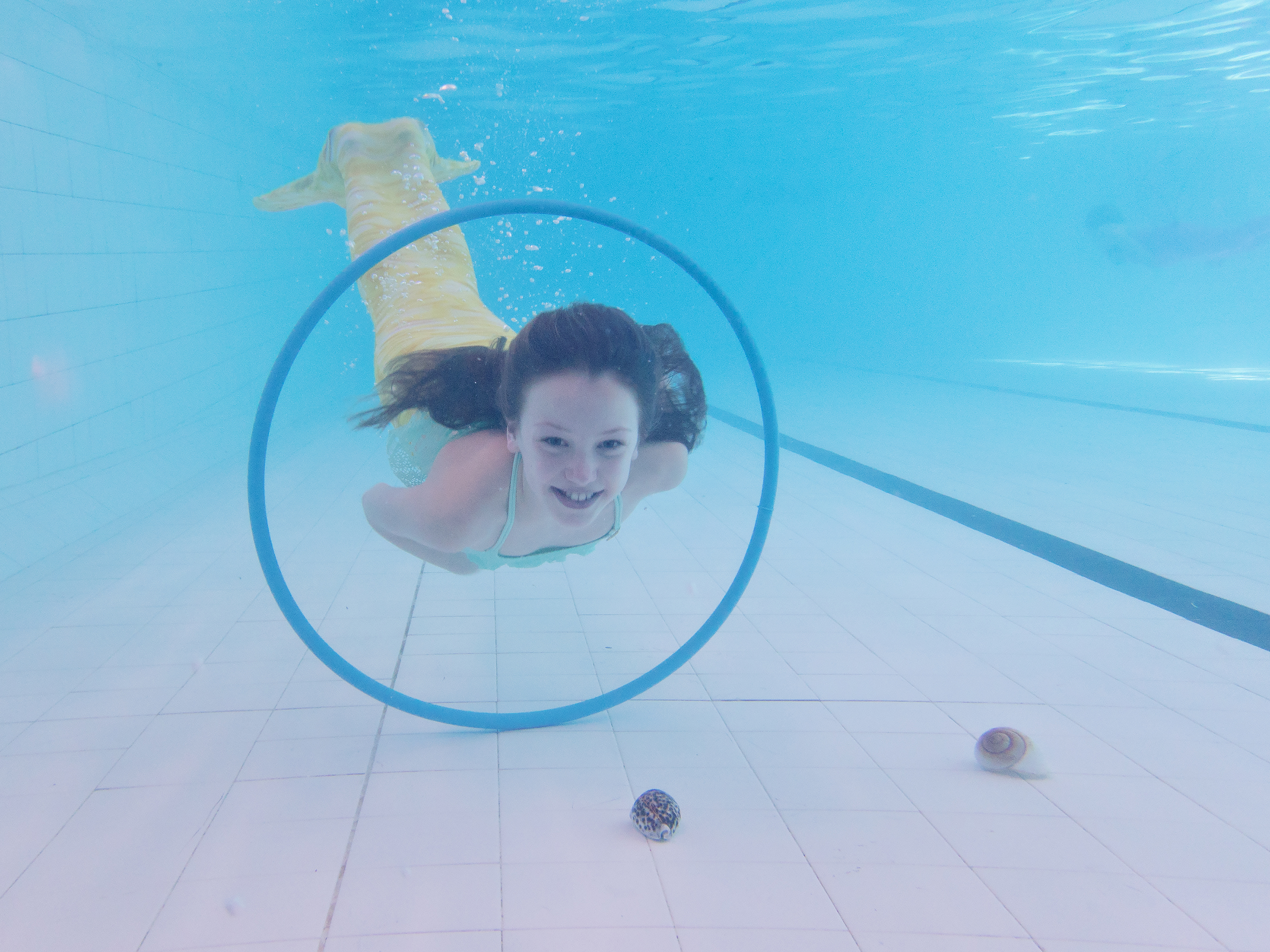 girl underwater in mermaid tail