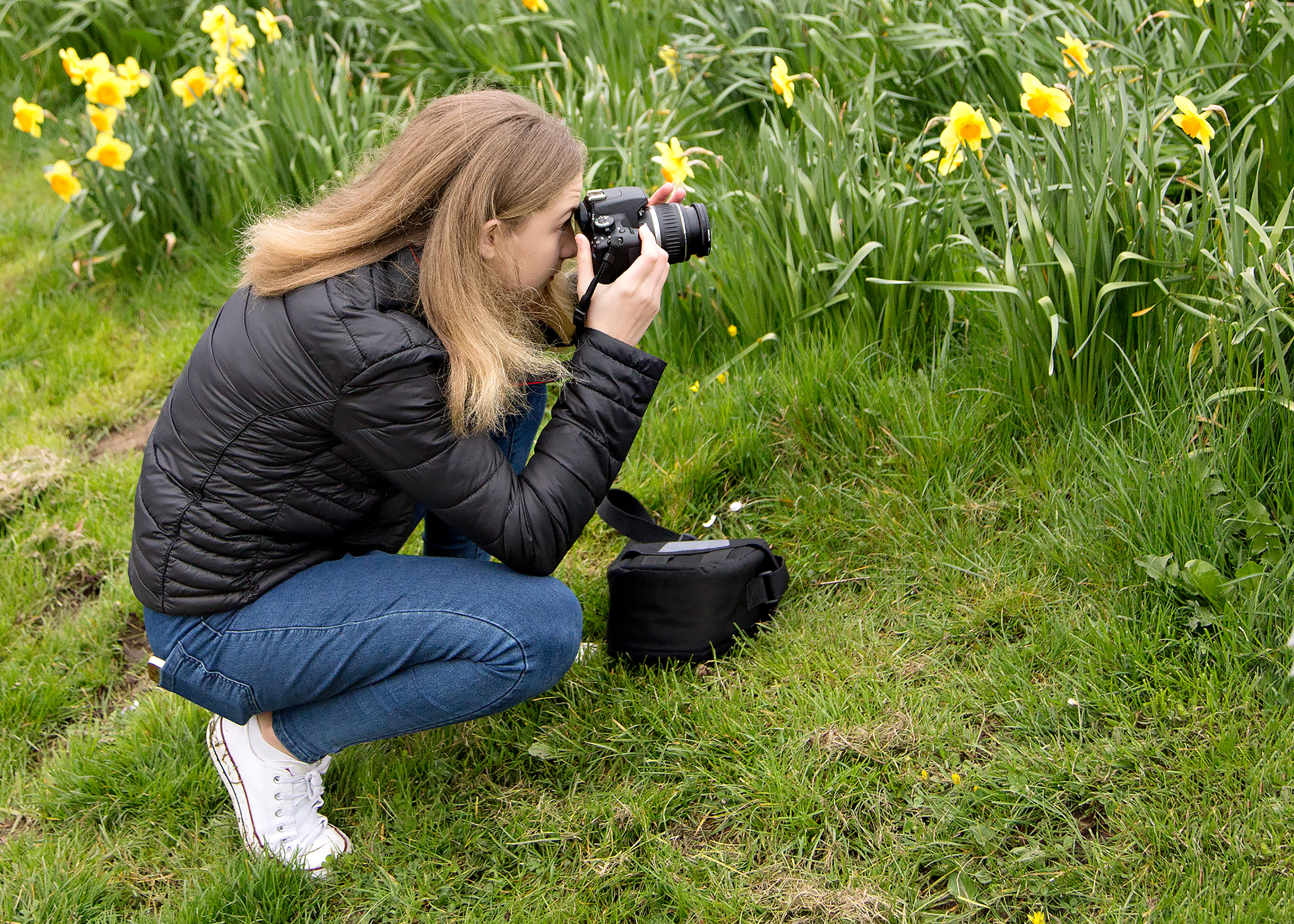 Girl taking a photo in a park