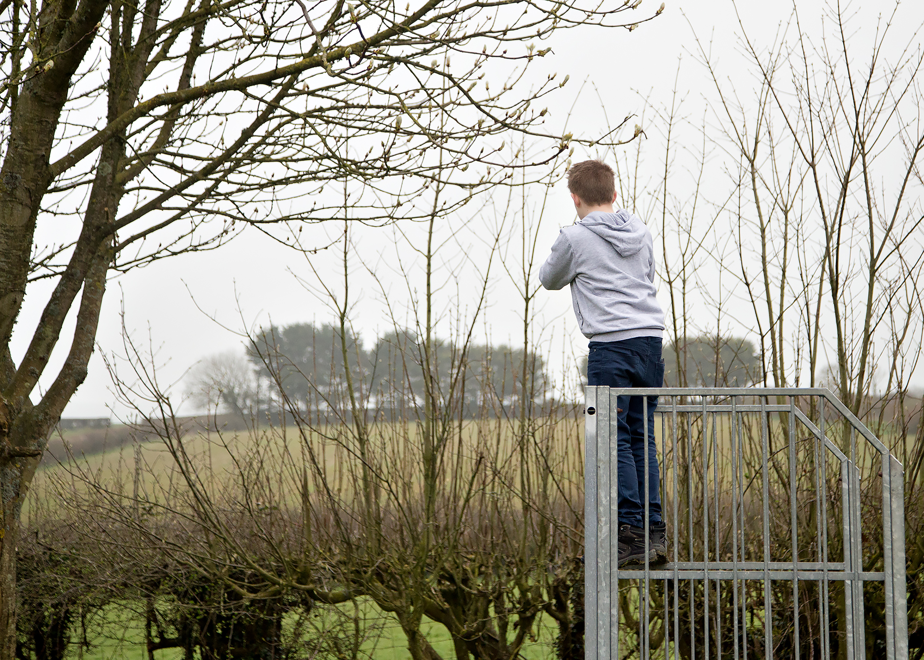 Boy taking a photo in a park Colwinston