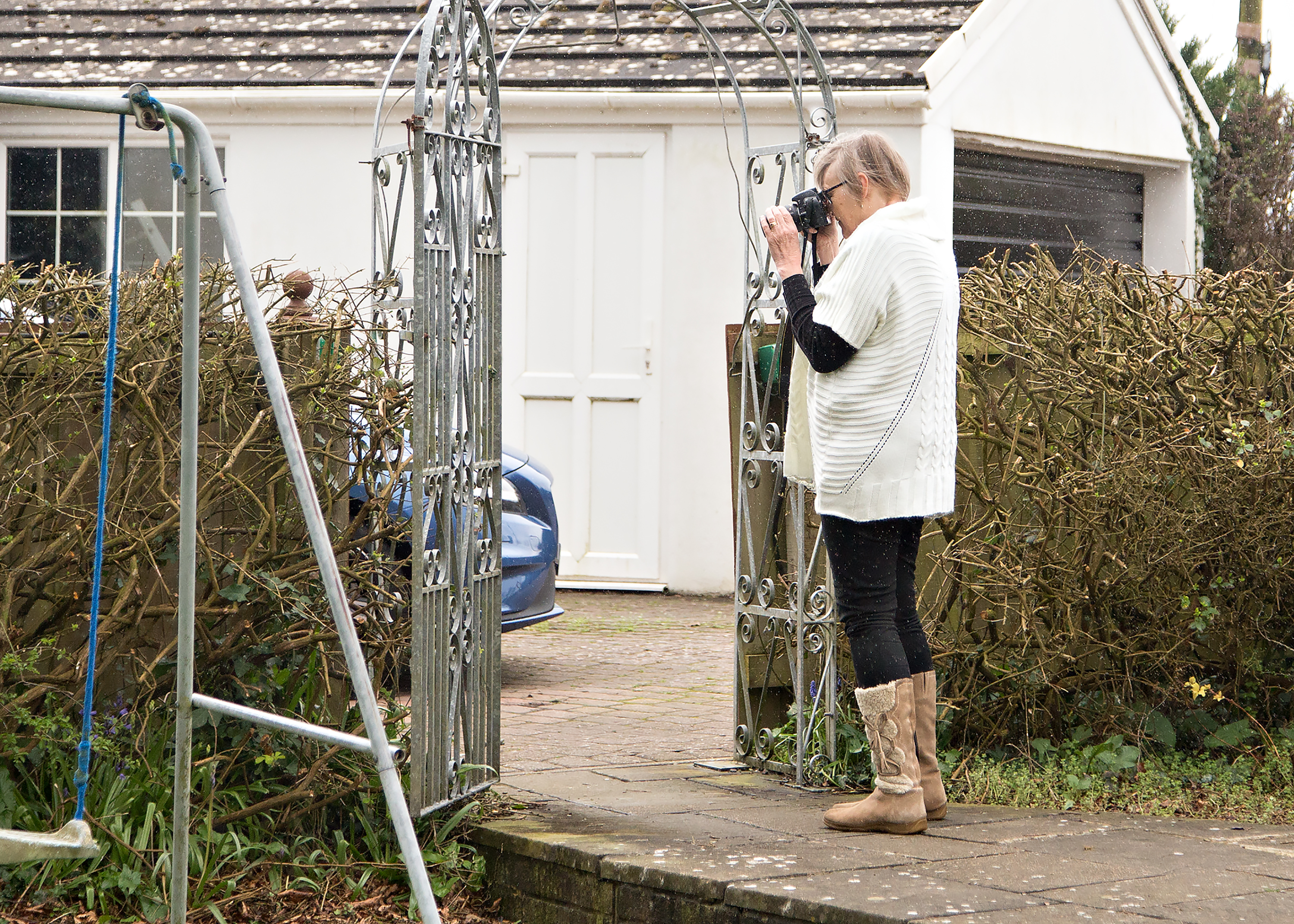 Woman taking photo on photography training course