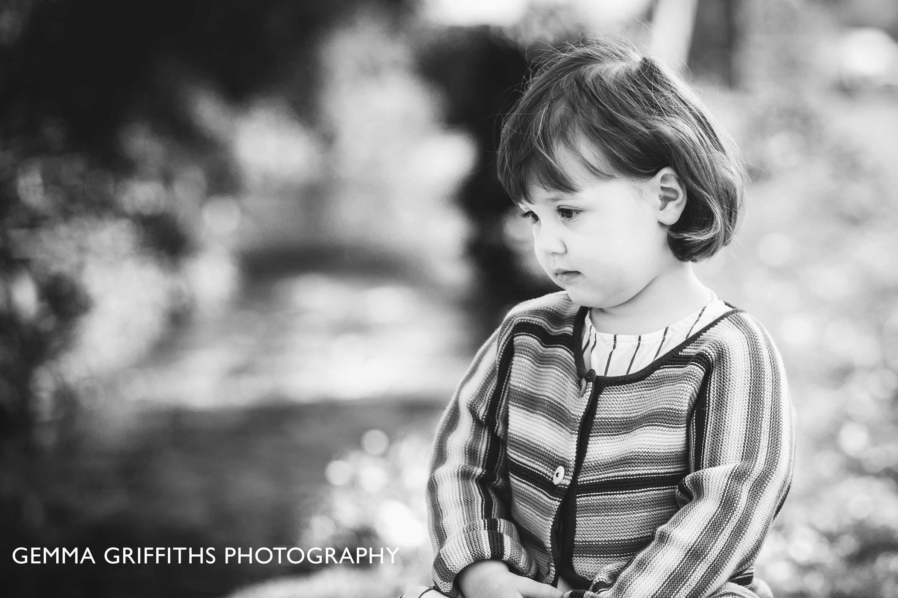 Little girl looking at a stream