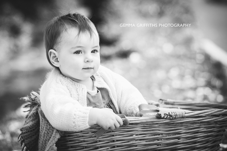 Baby sitting in basket