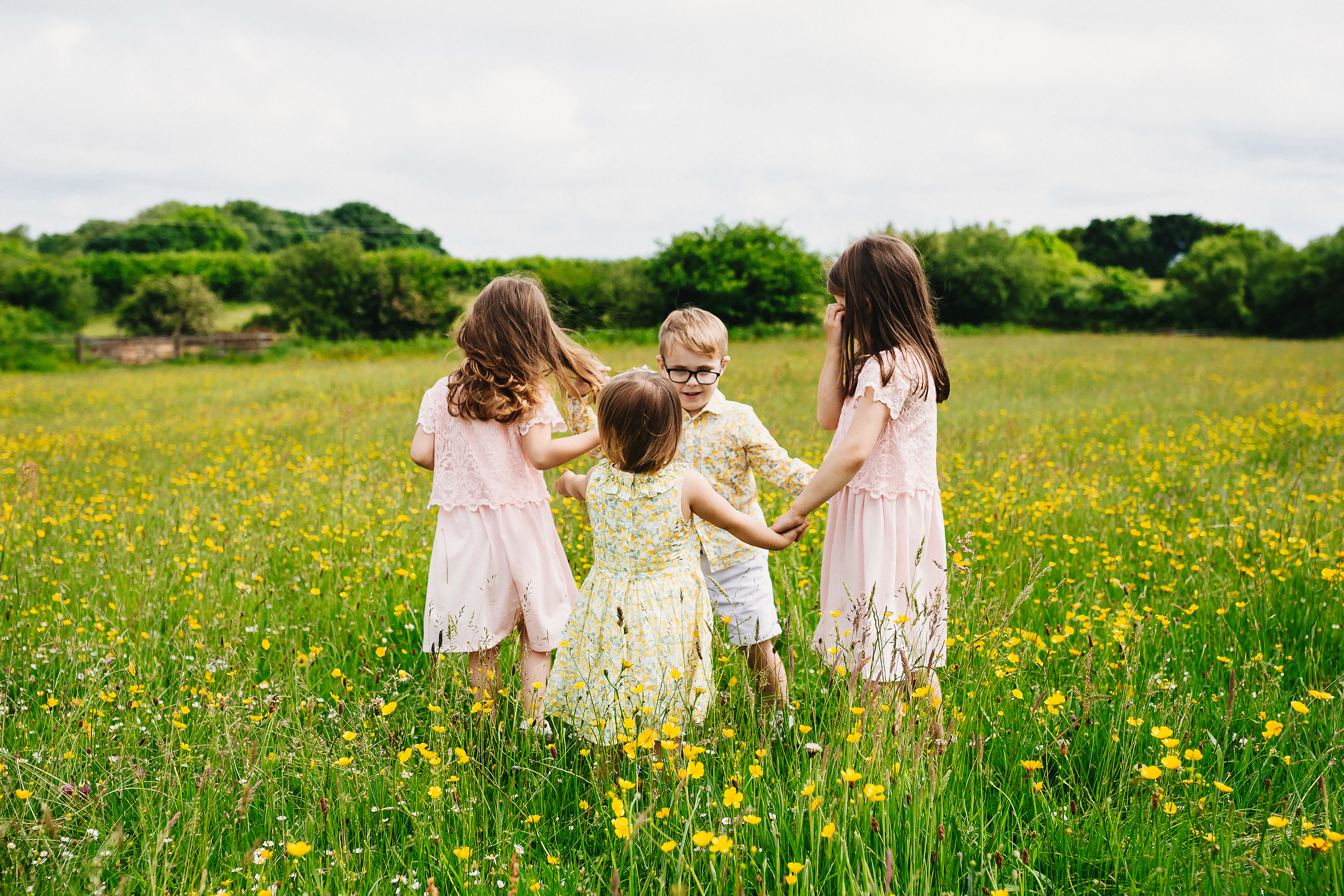 children dancing in meadow