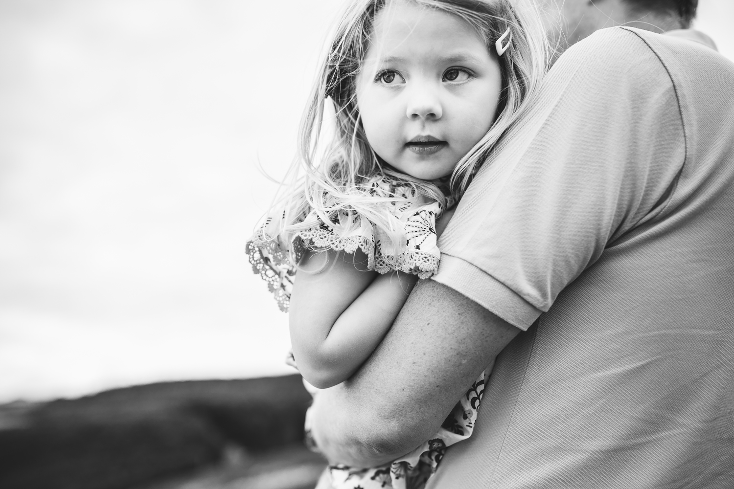 Little girl in Dads arms