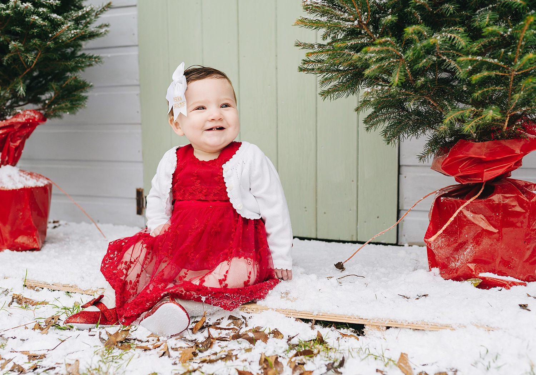 baby sitting in snowy set