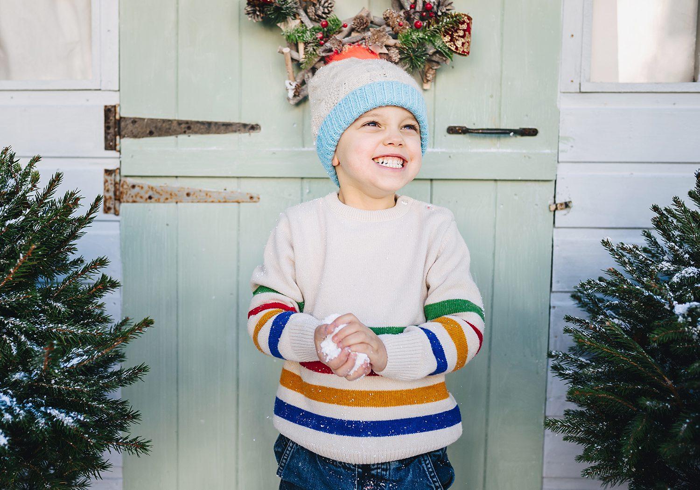 child holding snow