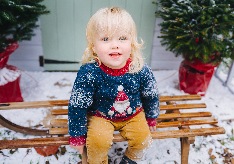 child on sledge