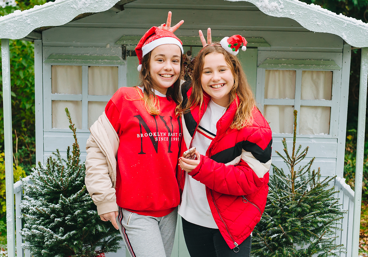 girls smiling in Christmas outfits