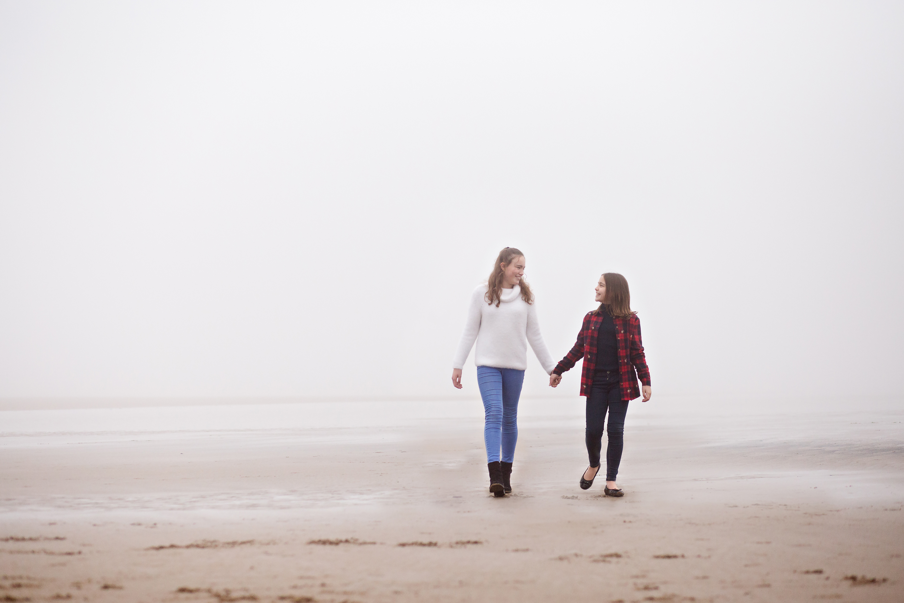 sisters walking in the fog