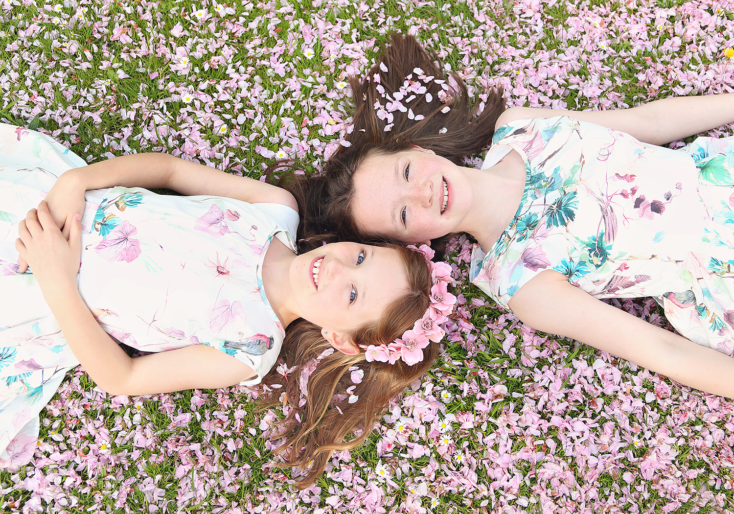 girls lying in blossom