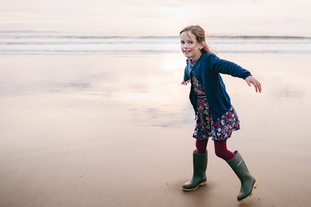 South Wales family beach shoot. Girl on the beach.