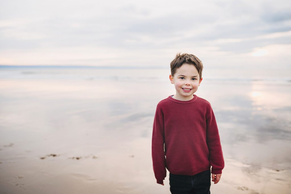 South Wales family beach shoot. Portrait of a boy on the beach.