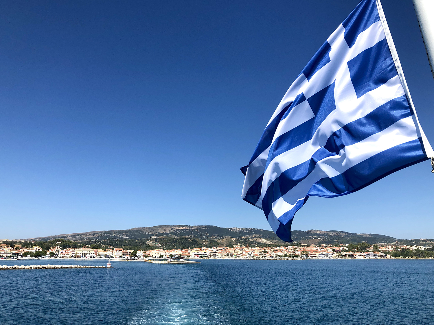 greek flag on the back of a ferry