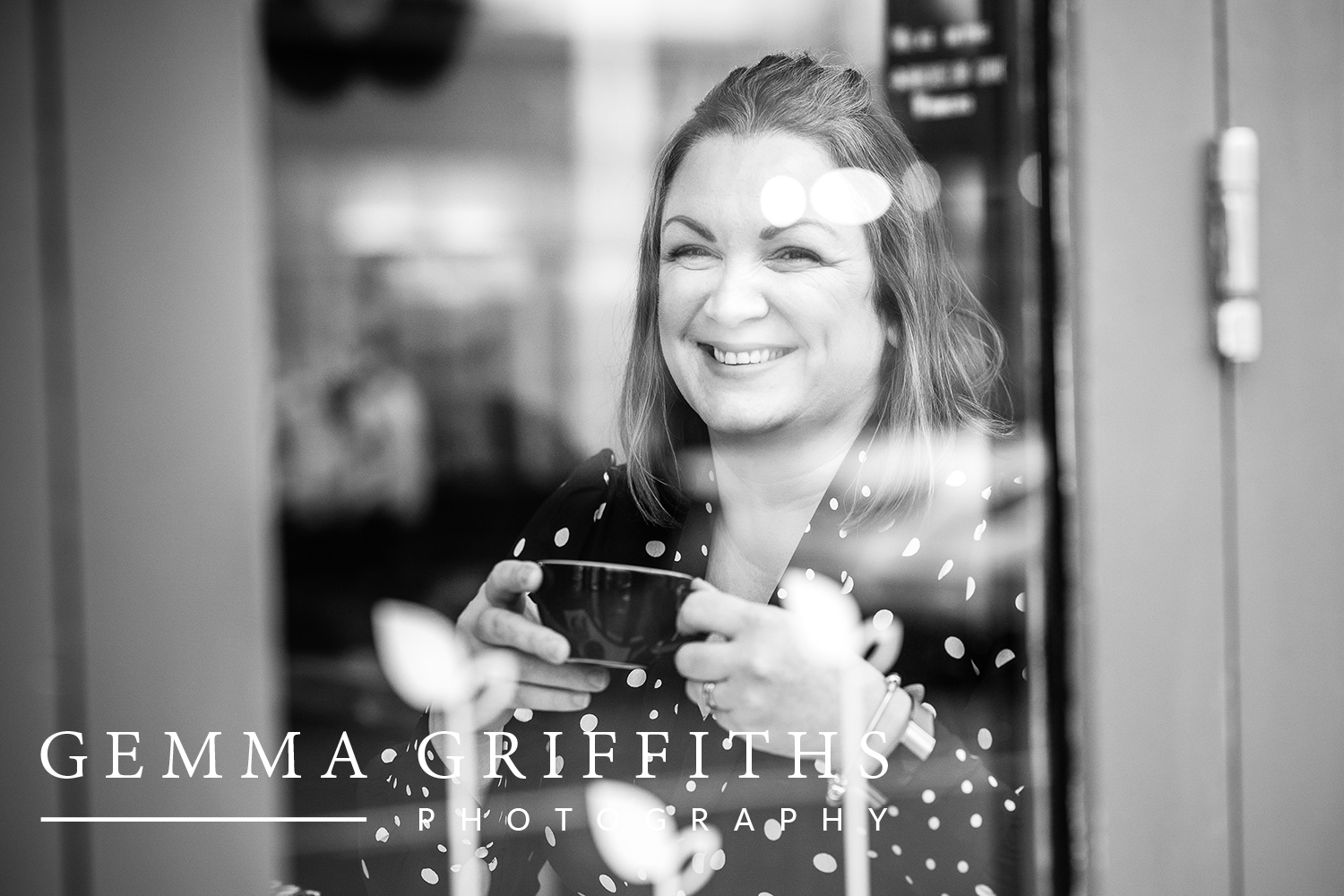 Headshot image of a woman in a cafe in Cowbridge