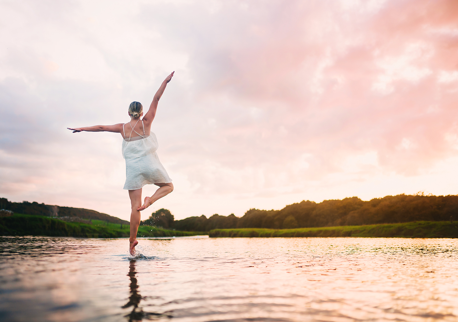 ballet dancer at sunset in a river