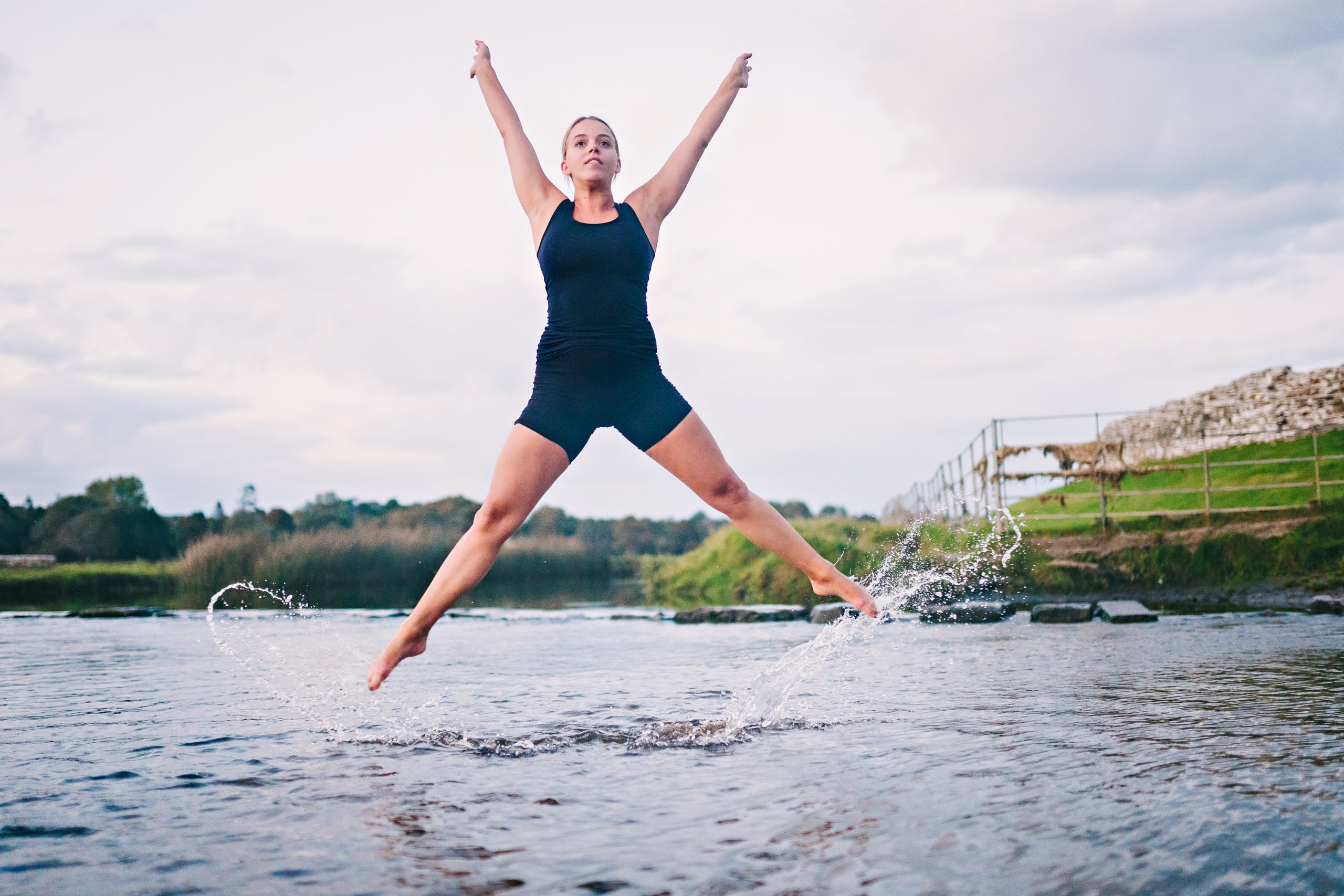 ballet dancer jumping in a river