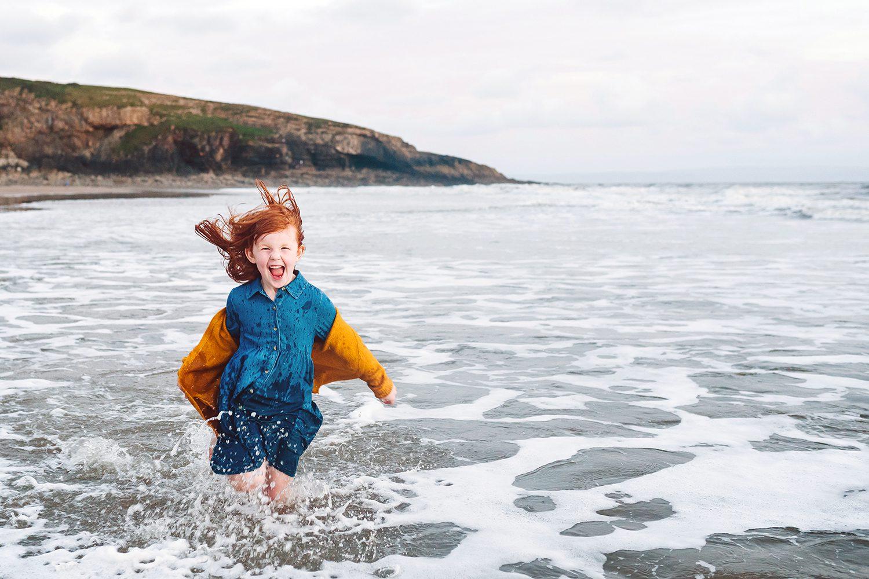 girl running in the sea